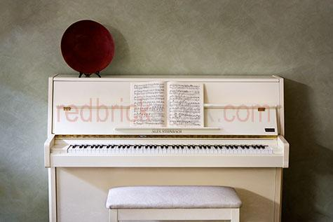piano;pianos;baby piano;baby pianos;cream piano;cream pianos;cream baby piano;cream baby pianos;white piano;white pianos;white baby piano;white baby pianos;music;sheet music;musical instrument;musical instruments;musical;instrument;instruments;piano key;piano keys;key;keys;piano stool;piano stools;piano chair;piano chairs;stool;stools;chair;chairs;music sheets;music book;music books;plate;plates;ornament;ornaments;against wall;wall;walls;copyspace;copy space;textspace;text space;interior;interiors;home;homes;family home;family homes;house;houses;alex steinbach;inside