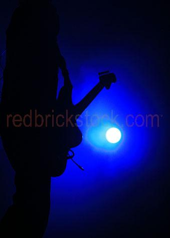 music musician guitar guitarist blue light stage lights performa