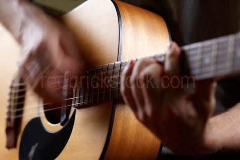 guy playing acoustic guitar;playing acoustic guitar;playing guitar;acoustic guitar;guitar;semi acoustic guitar;music;musician;musisians;guitars;live music;lead guitar;guitar picking;band;bands;performing;perform;performance;bending strings;bending guitar strings;instrument;instruments;musical;musical instruments;group;groups;stage;on-stage;on stage;guitarist;guitarists;solo;soloist;rock;guitar player;blues;blues guitar;folk guitar;country music;folk music;singing;strumming;strum;strumming guitar;maton;strings;guitar strings;fret;frets;fret board;neck;guitar neck