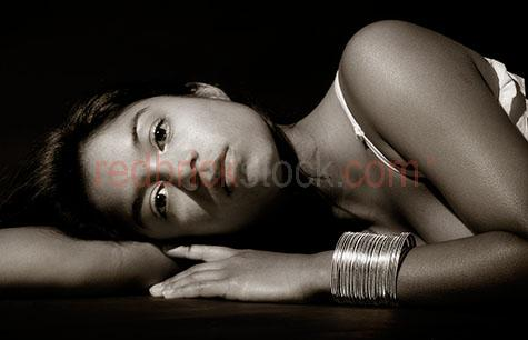 girl;lady;woman;laying;lying;looking at camera;indian;beauty