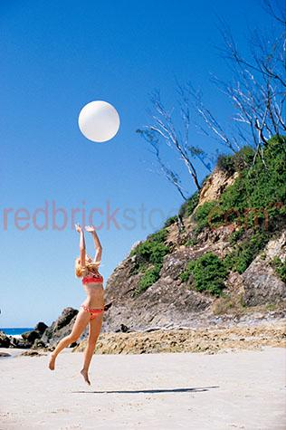 girl;girls;woman;young lady;bikini;ball;jump;jumping;play;playing;beach;beaches;coast;coastal;lifestyle;leisure;togs;bathers;swimsuit;swim suit;summer