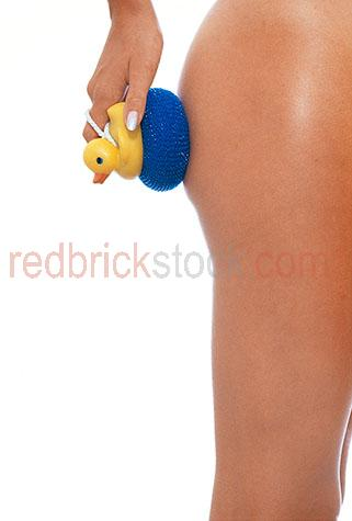rubber;ducky;duck;exfoliate;exfoliator;exfoliating;leg;tan;tanned;pamper;health;beauty;hand;leg;legs
