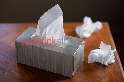 tissue;tissues;tissue box;tissue boxes;box of tissues;sick;cold;colds;flu;flus;sneeze;sneezes;sneezed;health;unhealthy;influenza;hayfever;allergy;allergies;hygiene;hygienic;unwell;one box;used tissue;used tissues;dirty tissues;dirty tissue;selective focus