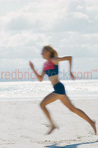 woman;women;young;fit;healthy;health;run;running;sprint;sprinting;beach;beaches;sand