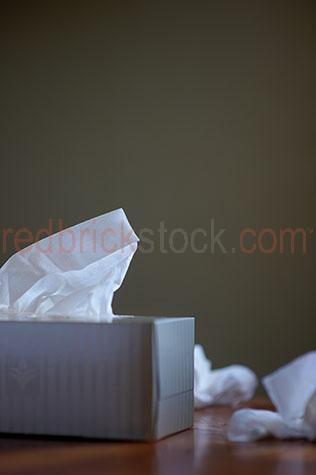 tissue;tissues;tissue box;tissue boxes;box of tissues;sick;cold;colds;flu;flus;sneeze;sneezes;sneezed;health;unhealthy;influenza;hayfever;allergy;allergies;hygiene;hygienic;unwell;one box;used tissue;used tissues;dirty tissues;dirty tissue;selective focus;copy space;copy spaces;text space;text spaces