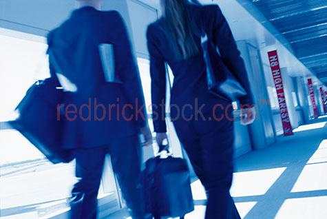 business couple walking man woman airport
