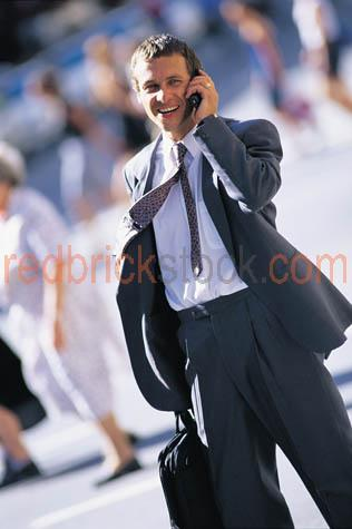 business;businessman;walking;talking;cell;phone;suit;street;busi;