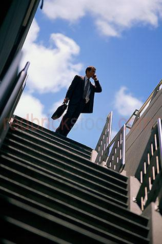 business businessman cell phone mobile stairs cellular telepnone