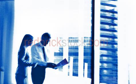 business;couple;businessman;business man;businesswoman;business woman;woman;man;office;office setting;abstract;business meeting;suit'suits;corporate;corporates;offices;hirise;highrise;hi rise;high rise;tower;towers;building;buildings