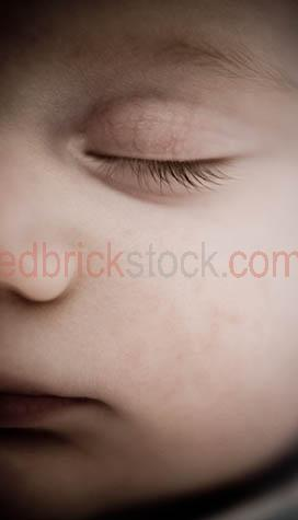 baby sleeping;baby asleep;infant;child;newborn;new born;baby sleeps;new born baby;newborn baby;eyes closed;close up;close-up;close up of baby's face;babies;small child;nuture;fragile;peaceful;peacefully asleep;kid;child;chldren;face;babies face;faces;dream;dreaming;baby dreaming;babies dreaming;parenthood;parent hood;angelic;nap;napping;baby napping;babies napping;slumber