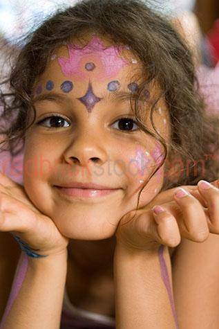 little girl young child daughter sister face paint painted cheer