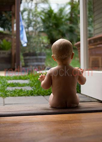 baby yard naked back own world looking infant young playing hous