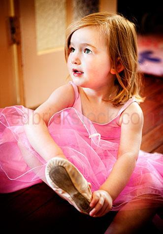 ballerina;ballerinas;ballet shoes;shoe;shoes;girl;girls;child;children;kid;kids;looking away;putting shoes on;tutu;tutus;little girl;little girls;young girl;young girls;blonde;blondes;blonde hair;strawberry blonde;blond;selective focus;wearing shoes;ballet flats;ballet flat;dance;dances;dance shoes;dancing shoes;dress;dresses;caucasian;5-10 years;5 to 10 years;5-10 yrs;5 to 10 yrs