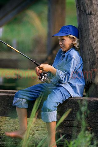 boy child young fishing fish outdoor activity outdoors rod reel
