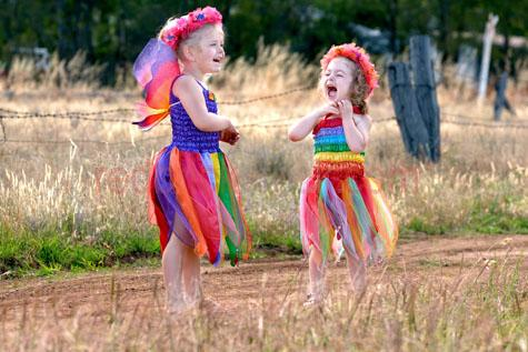little girls in fairy costumes;outback kids;country kids;country children;outback children;little girls playing;dressing up;rural children;aussie kids;aussie children;australian children;australian kids;laughing;having fun;enjoying themselves;kids party;childrens party;young children