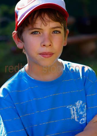 boy;young boy;aussie boy;boys;10-12 yr old;10-12 year old;10 to 12 yr old;10 to12 year old;10 to 12 years old;10-12 yrs old;boy at home;hat;cap;wearing hat;wearing cap;boy wearing cap;boy wearing hat;t-shirt;tshirt;outside;back yard