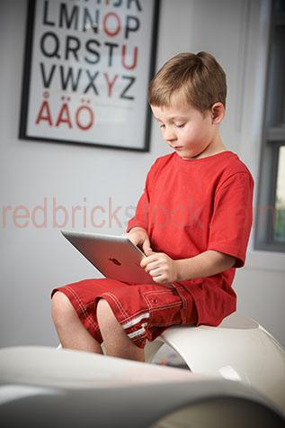 child;children;kid;kids;boy;boys;young boy;concentrating;concentration;thinking;deep in thought;learning;study;studying;teaching;education;computer;computers;using computer;apple computer;apple computers;apple;ipad;ipads;touch screen;touch screens;internet;google;google search;searching the internet;searching internet;googling;internet search;keyboard;track pad;surfing internet;online;technology;indoors;interior;inside;age 10-12;10-12;10-12 years;10 to 12 years;10-12 yrs;10 to 12 yrs;age 10-15;age 10-15 yrs;10-15 years;10 to 15 years;10-15 yrs;10 to 15 yrs;australia;australian;aus;homework;at home;home;alphabet;study room;study rooms;home study;home studies;kids learning;childrens learning;close-up;close-ups;close up;close ups;closeup;closeups;close-up view;close-up views;closeup view;closeup views;close-up views;close-up view's;close up views;closeup views;profile;side-on
