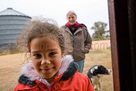farm;dog;outback;rural;grandaughter;grand daughter;grandmother;grand mother;young girl on farm;young girl looking at camera;girl looking at camera;girl on farm;family on farm in winter;dog;worker dog;farm dog;girl smiling;girls smiling;little girl;5-10 years;5 to 10 years;5-10 yrs;5 to 10 yrs