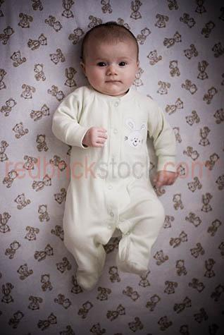baby wearing jumpsuit;baby in jumpsuit;babies wearing jumpsuit;babies iin jumpsuits;infant;child;newborn;new born;new born baby;newborn baby;babies;small child;nurture;kid;child;children;baby dreaming;parenthood;parent hood;angelic;baby in cot;baby in bed;babies in cot;babies in bed;babies in crb;baby in crib;baby smiling;baby smiles;young child;small child;one baby