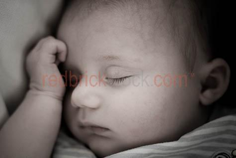 baby sleeping;baby asleep;infant;child;newborn;new born;baby sleeps;new born baby;newborn baby;eyes closed;close up;close-up;close up of baby's face;babies;small child;nuture;fragile;peaceful;peacefully asleep;kid;child;chldren;face;babies face;faces;dream;dreaming;baby dreaming;babies dreaming;parenthood;parent hood;angelic;nap;napping;baby napping;babies napping;slumber;babys hands;babys hand;babies hands;baby's hand;baby's hands
