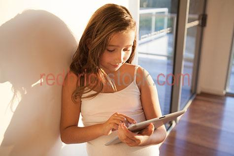 child;children;kid;kids;girl;girls;young girl;daughter;home;at home;ipad;ipads;tablet;tablets;computer;computers;using ipad;using tablet;using computer;apple;mac;macintosh;internet;surfing internet;searching internet;online;technology;indoors;interior;inside;age 10-12;10-12;10-12 years;10 to 12 years;10-12 yrs;10 to 12 yrs;age 10-15;age 10-15 yrs;10-15 years;10 to 15 years;10-15 yrs;10 to 15 yrs;copyspace;copy space;textspace;text space;australia;australian;close-up;close-ups;close up;close ups;closeup;closeups;close-up view;close-up views;closeup view;closeup views;close-up views;close-up view's;close up views;closeup views