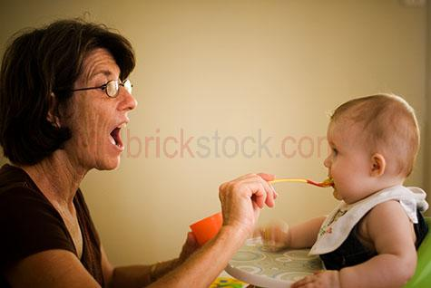 baby;babies;infant;infants;child;children;kid;kids;baby with grandma;baby with grandmother;babies with grandmas;babies with grandmothers;baby with grandparent;babies with grandparents;family;families;baby and grandmother;baby and grandma;baby and grandparent;baby and grandparents;baby & grandma;baby & grandmother;baby & grandparent;generations;generation;two people;parent;parents;grandma feeding grandchild;grandma feeding baby;grandmas feeding babies;grandmother feeding baby;grandmother feeding grandchild;grandmothers feeding babies;woman feeding baby;women feeding babies;lady feeding baby;ladies feeding babies;grandparent feeding baby;grandparents feeding babies