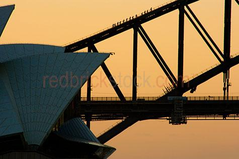 climbers;climbing;sunset;dusk;sydney harbour bridge;sydney opera house;silhouette of sydney harbour bridge;bridges;city bridge;city bridges;cities bridges;capital city;capital cities;sydney;nsw;new south wales;tourist destination;iconic;icon;iconic landmark;australia icon;australia icons;icons;entertainment;climbers on sydney harbour bridge;architecture;architectual;sun set over sydney harbour bridge;sunset over sydney harbour bridge;sunset over sydney opera house;sun set over sydney opera house;buiding;buildings;popular tourist destination australia