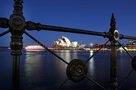 sydney opera house;iconic;city;capital city;cities;twilight;fence;landmark;building;buildings;architecture