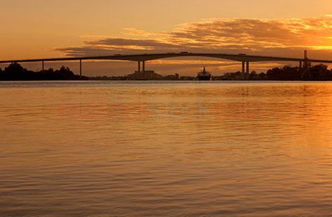 gateway bridges bridge brisbane city sunrise sunset ship shippin