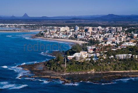 caloundra;coast;coasts;coastal;seaside town;seaside towns;seaside;seasides;sea side;sea sides;ocean;oceans;shore;shores;shorelines;shore lines;rocky shoreline;rocky shorelines;rocky shore;rocky shores;town;towns;holiday;holidays;holiday town;holiday towns;buildings;dwellings;cliff;cliff top;clifftop;clifftops;cliff tops;cliffs;glass house mountains;queensland;queensland coastal town;queensland coastal towns;queensland towns;south east queensland;southeast queensland;getaway;getaways;tourism;blue sky;blue skies