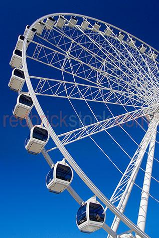 the wheel of brisbane;ferris wheel;entertainment;icon;landmark;south bank;southbank;world tourist attractions australia;brisbane wheel;brisbane eye;wheel of brisbane against blue sky;brisbane wheel against blue sky;brisbane eye against blue sky;brisbane ferris wheel;ferris wheel brisbane