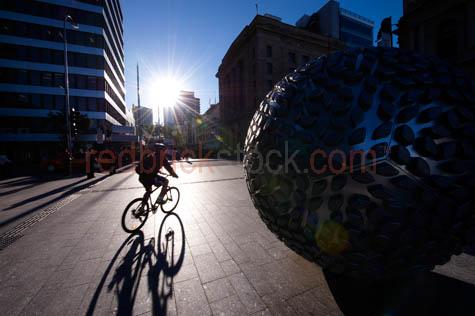 anzac square;anzac square brisbane;brisbane;mall;queen street;queen st;queen street mall;queen st mall;public places;public spaces;streescape;streetscapes;street scapes;metro;public art;urban art;urban sculpture;urban;sculpture;sculptures;ball;balls;cyclist;cycling;bicycle;riding bicycle;man;silhouette;silhouetted;silhouettes;backlit;backlight;backlighting;people;pedestrian;pedestrians;city;citys;city's;cities;capital;australia;australian;footpath;sidewalk;footpaths;sidewalks