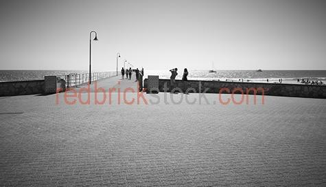 adelaide;glenelg;south australia;sth australia;sa;beach;beaches;australia;australian beaches;lifestyle;b&w;black & white;b+w;mono;monochrome;wharf;wharfs;jetty;jetty's;pier;piers;teen;teens;teen couple;teen couples;cobblestone;leading line;ocean;youth;young people;young;australian;copy;copyspace;and;&;+