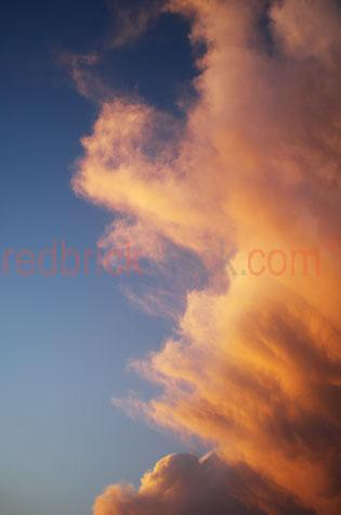 clouds cloud cloudscape sky skies orange sunset storm rain
