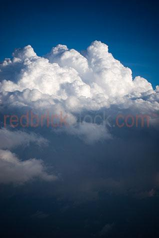 above the clouds;flying above clouds;cloud;clouds;white clouds;white cloud;fluffy white cloud;fluffy white clouds;cumulus;cumulonimbus;sky;skies;cumulus clouds high in the sky;high in the sky;blue sky;blue skies;clouds high in the sky