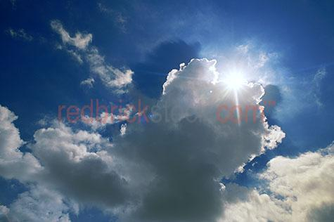 clouds cloud sky skies fluffy white sun storm rays