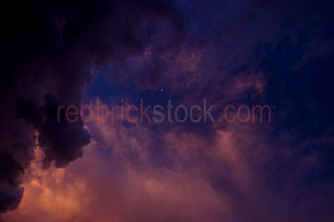 sky;skies;skys;sky's;cloud;clouds;cloudy;storm;stormy;storm cloud;storm clouds;dark cloud;dark clouds;cumulonimbus;cumulus;stormy sky;stormy skies;sunset;evening;dusk;twilight;evening sky;moon;cresent moon;copyspace;copy space;textspace;text space