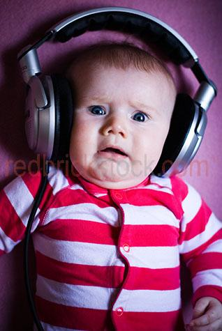 baby;babies;child;children;kids;kid;infant;baby wearing headphones;baby looking scared;scared baby;terror;baby listening to music;babies listening to music;child listening to music;children listening to music;scared infant;scared child;horror;oversized headphones;upset baby;baby upset;upset babies
