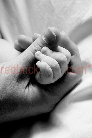 holding baby hand mother nuture love care caring born birth moth