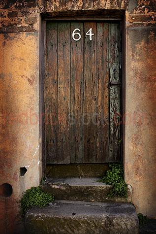 old wooden door;timber door;doors;64;steps;stoop;entry;entry way;enter;front door;doorway;closed door