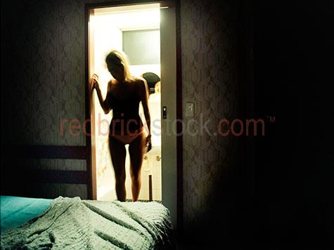 girl standing in doorway;woman standing in doorway;young woman standing in doorway;silhouetted;woman silhouetted;girl silhouetted;young woman silhouetted;domestic violence;woman in bathroom;girl in bathroom;young woman in bathroom;bed;bedroom;woman in bedroom;young woman in bedroom;girl in bedroom;drug abuse;drug addict;drug addiction;drug use;alone;woman alone;girl alone;young woman alone;lonely;lonely woman;lonely girl;lonely young woman;isolated;depression;lonliness;solitude;emotion;emotional