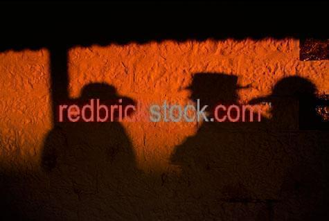 shadow;shadows;shadows of country men;country;countries;wall;walls;background;backgrounds;acubra;acubras;men in hats;men wearing hats;man in hat