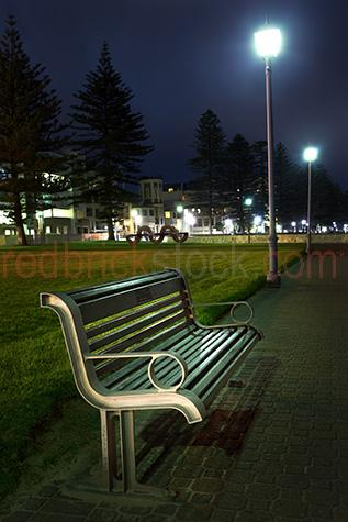 seat;seats;park bench;park benches;bench;benches;park;parks;public;public place;public places;empty;empty seat;empty seats;empty park bench;empty park benches;no people;deserted;vacant;foreshore;foreshores;street lights;street light;street lighting;night;nighttime;night time;night-time;south australia;adelaide;glenelg;seedy;homeless;homeless people;homeless shelter;bleak