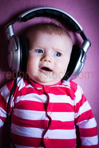 baby;babies;child;children;kids;kid;infant;baby wearing headphones;baby looking scared;scared baby;terror;baby listening to music;babies listening to music;child listening to music;children listening to music;scared infant;scared child;horror;oversized headphones;upset baby;baby upset;upset babies;unsure;unsure baby;hesitant baby;hesitant;anxious;doubt;doubtful;uncertain
