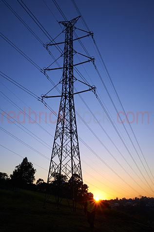 power pole;power poles;powerpole;powerpoles;electricity grid;energy grid;electricity grids;energy grids;energy;energies;line;lines;power line;power lines;powerlines;powerline;technology;cable;cables;voltage;power supply;power supplies;electricity supply;electricity supplies;network;utility;utilities;telephone wire;telephone wires;communication;communications;global issue;global issues;innovation;climate control;global warming;climate change;global issue;global issues;emission;emissions;smog;greenhouse;greenhouse gasses;greenhouse gas;carbon emission;carbon emissions;pollutants;pollutant;industry;industrial;atmosphere;high tension powerlines;high tension powerline;high tension power lines;high tension power line;carbon trading;emission trading;carbon emission trading;electricity pylon;electricity pylons;blue;blues;colour blue;color blue;blue sky;blue skies;clear blue sky;clear blue skies;sunrise;sunrises;sun rise;sun rises;sunrising;sun rising;sun;bright sun;sunburst;sun burst;sunray;sunrays;sun ray;sun rays;sunbeam;sunbeams;sun beam;sun beams;ray of light;rays of light;tree;trees;silhouette;silhouettes;silhouetted;silhouetted electricity pylons;silhouetted powerpoles;silhouetted power poles;silhouetted electricity grids;silhouetted energy grids;silhouetted powerlines;silhouetted power lines;copyspace;copy space;textspace;text space;worker;workers;working;work;works;electrical worker;electrical workers;hardhat;hardhats;hard hat;hard hats;high vis;high vis clothing;high visual;high visual clothing;high vis vet;high visual vests;safety clothing;safety gear