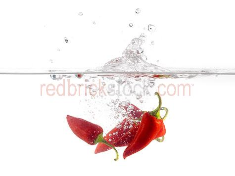 chili;chilies;chilis;chilli;chillis;chilli's;spices;spice;spicy;food;hot;fresh food;ingredient;ingredients;red chili;red chillies;red chilies;red chilli;green chili;green chilies;green chillies;green chilli;green chilli;green chillis;flavour;flavor;flavouring;flavoring;flavors;flavours;pepper;peppers;red pepper;red peppers;green pepper;green peppers;raw;uncooked;splashing into water;drop;dropping;dropped;splash;splashes;bubble;bubbles;fresh;raw;uncooked
