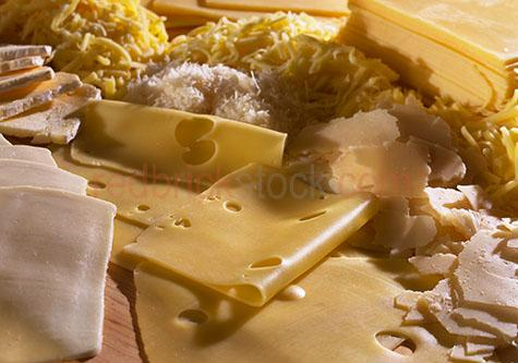 cheese;cheeses;cheese slice;cheese slices;slices of cheese;slice of cheese;swiss cheese;swiss cheeses;parmesan;grated cheese;grated cheeses;portion;portions;piece;cheese selection;cheese selections;assorted cheeses;assorted cheese;dairy;yellow;yellows;colour yellow;color yellow
