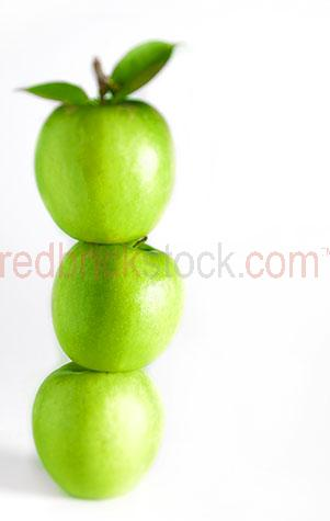 apples;apple;green apple;green apples;fruit;fruits;food;fresh;granny smith;healthy;health;ripe;ripen;ripened;raw;uncooked;three;3;trio;white background;white backgrounds;on white;copy space;copy spaces;text space;text spaces;diet;diets;stack;stacks;stacked;pile;piles