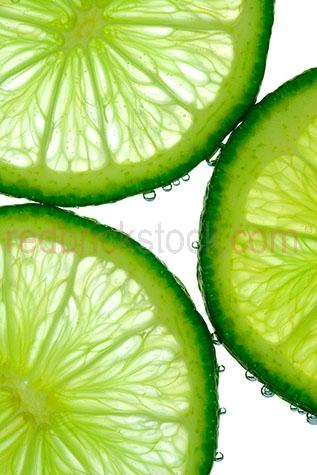 lime;limes;citrus;fruit;fruits;cut;cuts;slice;sliced;slices;raw;uncooked;white background;white backgrounds;on white;vitamin c;juicey;juicy;health;healthy;tropical fruit;tropical fruits;green;greens;colour green;color green;cut out;cut outs;cut-out;cut-outs;peel;peels;zest;droplet;droplets;water droplet;water droplets;bubble;bubbles;3;three;trio
