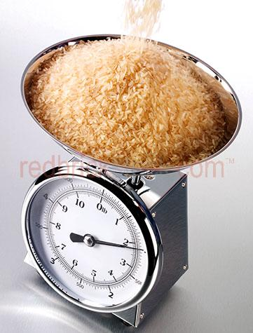 brown rice;rice;rices;brown rices;pouring;pour;pours;kitchen scales;kitchen scale;kitchenware;kitchen ware;kitchen;kitchens;scales;scale;metal;metals;chrome;measure;measuring;measures;weights;weight;weighing;ingredient;ingredients;stainless steel;appliance;appliances;bowl;bowls;heavy;uncooked;raw;uncooked rice;grain;grains;long grain rice